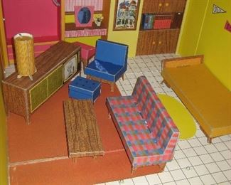 Barbie's original dream house constructed of cardboard. Folds into easy carrying case!