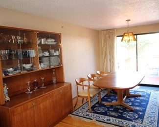 Teak cabinet and teak dining room table with 6 mid century chairs if desired.