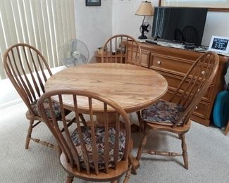 Oak dining room table and chairs and matching sideboard