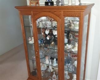 Curio cabinet full of art glass, willow tree, snow bunnies, Waterford, Royal Doulton and Lenox