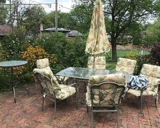 Pretty outdoor set with newer cushions and umbrella