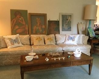 Mid-century down sofa, tables and lamps.  Artwork by the homeowner.