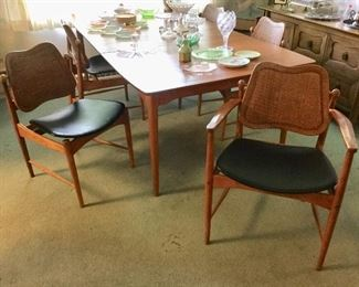 Swivel-back caned chairs