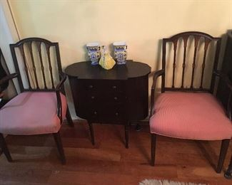 2 Antique Chairs with antique sewing table which has flip up side top pieces for storage.
