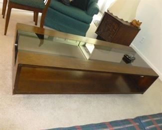 Unusual long mid-century modern coffee table w/smoked glass top