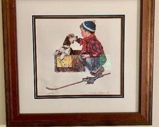 Framed Norman Rockwell art.