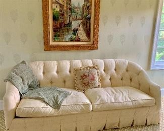 Two seat tufted back sofa with pleated skirt.  Kellogg Collection.