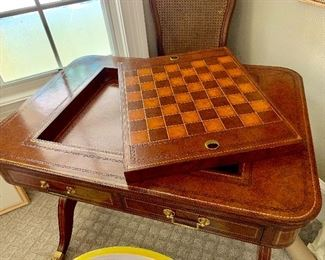 Maitland-Smith game table with brass casters