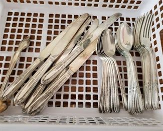 Unbranded sterling flatware for eight
