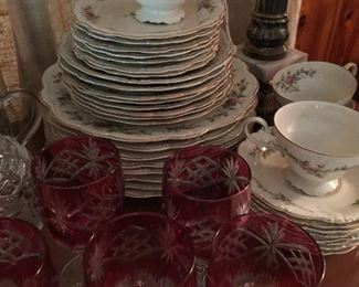 Many sets of china and crystal stemware