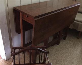 Nice sized gate-leg table, wooden magazine rack.
