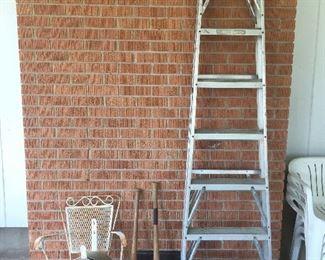 Another ladder, cool chair, baseball bats.