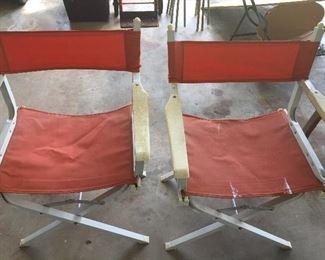 Pair of folding aluminum directors chairs.