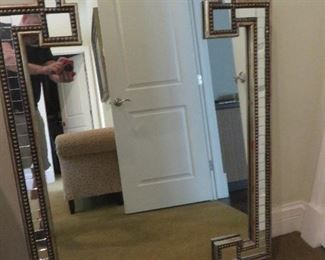 John Richards Omega Mirror.  35''W X 49''H X 2''D A clear center mirror is framed by smaller individual mirrors with beaded molding. It is equipped to hang vertically or horizontally.