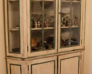 Distressed Corner Cabinet loaded with sterling