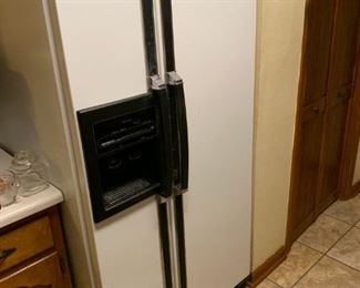 Kenmore SXS Refrigerator with water and ice on the door