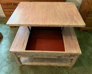 Distressed table showing lift top