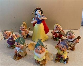 Vintage Disney Snow White and the Seven Dwarfs porcelain figurines.