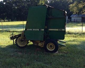 John Deere 335 Hay Roller.