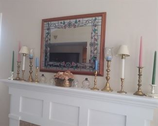 Large variety of candlesticks and mantle mirror