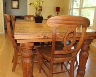 Amazing dining room table - seats 10 comfortably, includes 12 chairs.