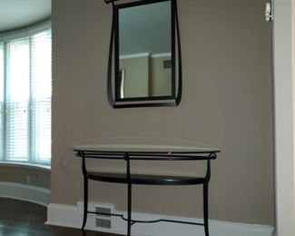 Glass top console table with companion mirror