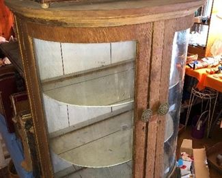 Small curved glass oak display cabinet