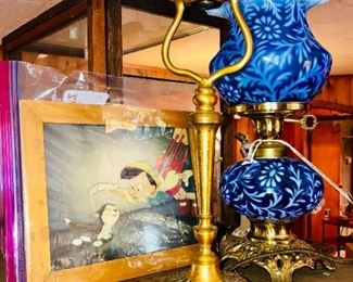 "An amazing collection:  Original Walt Disney Pinocchio celluloid movie cell, a Louis C. Tiffany Furnaces Inc. ""Favrile"" lamp, and a Fenton/L.G. Wright ""Daisy & Fern"" lamp."