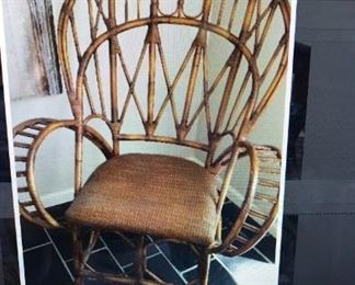 Pair of Rattan Chairs, with woven smooth cane seats, custom made exclusively for Bloomingdales, to use in the Ralph Lauren Sport clothing line.  One of a kind, unbelievable find, chairs have a signed brass plate on the bottom.
