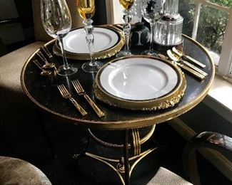 Dinner for two on an French antique gueirdon table, Christian Dior service plates are from a collection of 10.