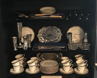 Silver service pieces and 12 place settings of Royal Doulton Rhodes china.