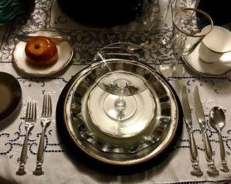 At the table we have Royal Dalton china the pattern is Rhodes, the sterling flatware is Romance of the Sea by Wallace and the crystal stemware is Baccarat Perfection and a Lenox gold rimmed water goblet.