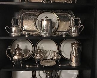Christian Dior service plates and silver coffee and tea services.