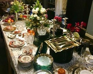 Welcome to the dining room where you will find five sets of fine china, service plates, chargers, seven different stemware patterns silver service linens and so much more!