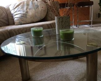 this is coffee table with glass and made of metal.