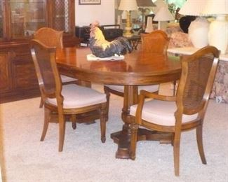 A BETTER PICTURE OF THE DINING TABLE AND CHAIRS.  THIS SET HAS A TABLE,4 CHAIRS,CHINA CABINET, SERVER, LEAF AND PADS