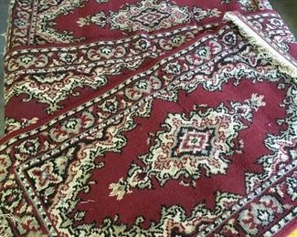 Various sized throw rugs