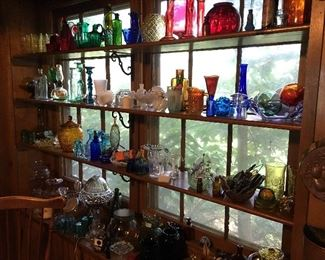 Various vintage and antique glass pieces including glass floats, a glass lamp, and more.