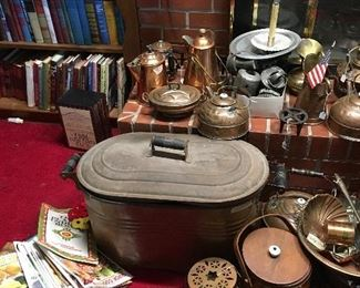 Antique copper boiler, copper tea pots, copper bakeware, copper coffee pots, and more copper. As well as vintage hardback books and magazines.