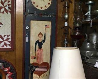 Folk art Americana clock, reading lamp, quilt wall hangings