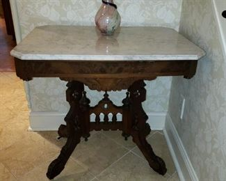 Antique foyer table with marble top and porcelain castors