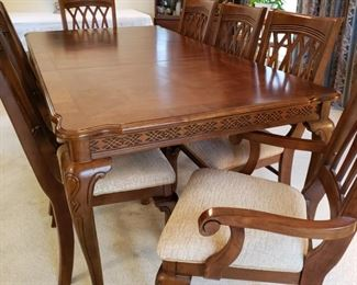Lovely dining room table with chairs
