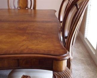 Benchmark dining room table with 2 leaves and 6 chairs. Matching china cabinet.
