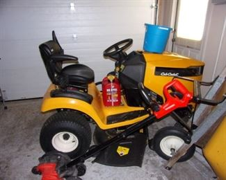 2017 Cub Cadet XT2 riding lawn tractor/mower- can purchase wagon to pull behind as well! Cub Cadet also added armrests. These can be added to XT1 models but is standard for XT2 tractors to give you a little added comfort. The XT2 models have larger engines so you have an increase in performance. ... Other models have a lever to push to engage the mower, but these tractors have a switch.