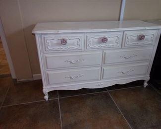 Antiqued white 7 drawer dresser with rose handles
