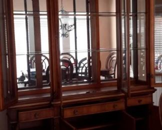 Benchmark lighted china cabinet. Matching dining room table and chairs.