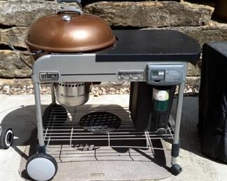Weber 15502001 Performer Deluxe Charcoal Grill, 22-Inch, Copper -22-inch diameter porcelain-enameled bowl and lid with a cooking area of 363 square inch Electronic Touch-N-Go gas ignition system Aluminized steel One-Touch cleaning system with removable, high-capacity, aluminum ash catcher Removable LCD cook timer and built-in lid thermometer Assembled dimensions are 43.5-inch by 48-inch by 30-inch.Tuck-Away lid holder & Cover. New with cover on Amazon $450.......OUR PRICE $150