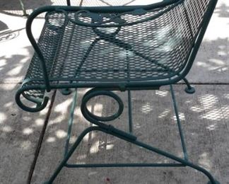 Wrought iron green patio table and four spring action chairs!