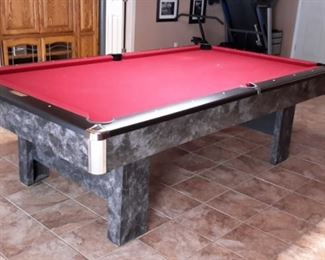 Contender by Brunswick in Graphite laminate/wood/metal with red felt includes pool table accessories such as cues.