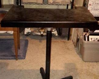 Adjustable height, moveable desk/writing platform desk.
